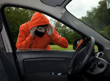Burglar wearing a mask (balaclava), car burglary Stock Photos