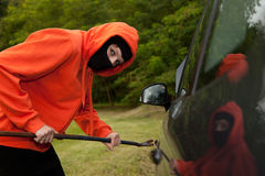 Burglar wearing a mask (balaclava), car burglary Royalty Free Stock Photography