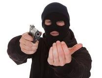 Burglar Wearing Mask Holding Gun. Burglar Wearing Mask Aiming Gun Towards Camera Royalty Free Stock Photography