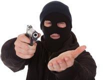 Burglar Wearing Mask Holding Gun. Burglar Wearing Mask Aiming Gun Towards Camera Royalty Free Stock Photos