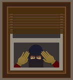Burglar at Window. Burglar in disguise peering through window of house he intends to break into Stock Images