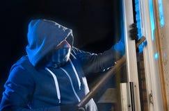 Burglar at work stock images