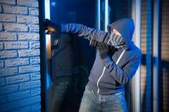 Burglar at work Royalty Free Stock Photo