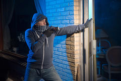 Burglar at work Stock Images