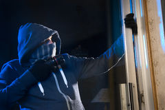 Burglar at work. A burglar is trying to get into a house by the backdoor royalty free stock photos