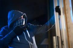 Burglar at work Royalty Free Stock Photos