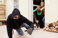 Burglars flee from the crime scene. Burglars try to flee from the crime scene Royalty Free Stock Image