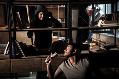 Burglars and scared man Royalty Free Stock Photography