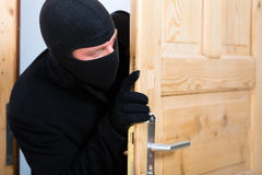 Burglary crime - burglar opening a door Royalty Free Stock Photo