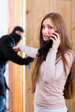 Burglary crime - culprit and victim Royalty Free Stock Image
