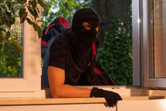 Burglary by the window Royalty Free Stock Image