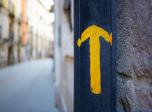 Burgos city Way of Saint James yellow arrow sign Stock Images