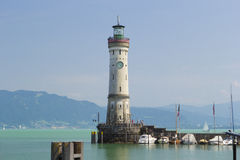 Lindau lighthouse. Mysterious lighthouse in harbor of Lindau in lake Constance, Germany Stock Photos