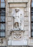 Burgundian Merchant by Hugo Haerdtl, Neue Burg or New Castle, Vienna, Austria. Pictured is one of twenty statues on the façade of the Neue Burg or New stock image