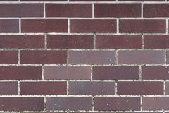 Burgundy ściana z cegieł, tekstury tło Zdjęcia Stock