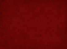 Burgundy Background. A textured, dark red background with a subtle vignette Royalty Free Stock Image