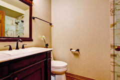 Burgundy bathroom vanity cabinet with white sink Stock Images