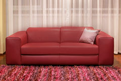 Burgundy couch Stock Photo