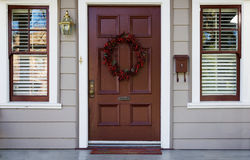 Burgundy door and 2 windows Royalty Free Stock Photography