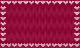 Burgundy fabric knitted background framed with knit white hearts Stock Images