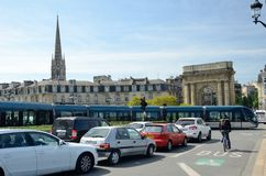 The Burgundy gate and a famous tram in Bordeaux. The modern cable-free tram runs near the ancient gateway Porte de Bourgogne in the French city Bordeaux Royalty Free Stock Photos