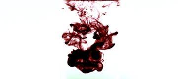Burgundy ink swirl Royalty Free Stock Photo