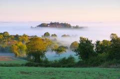 Burgundy landscape in morning mist Stock Photos