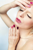 Burgundy multi-colored manicure. Royalty Free Stock Photo