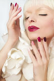 Burgundy multi-colored manicure and makeup . Royalty Free Stock Photography