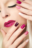 Burgundy multi-colored manicure and makeup . Royalty Free Stock Photos