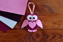 Burgundy and pink felt owl toy Stock Images