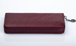 Burgundy purse. Leather female purse on light background Royalty Free Stock Images