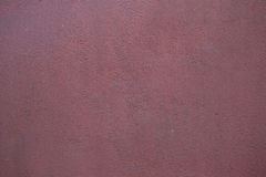 Burgundy red painted stucco wall. Background texture Stock Photography
