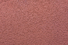 Burgundy red painted stucco wall. Background texture Stock Image