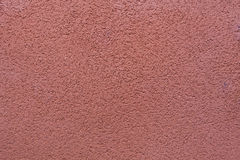 Burgundy red painted stucco wall. Background texture Royalty Free Stock Photos
