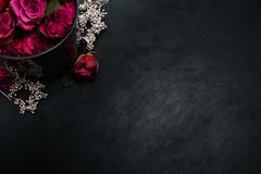 Burgundy red roses dark background passion love. Burgundy or wine red roses and silver decor on dark background. True love passion and desire. Copy space concept Royalty Free Stock Images