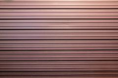 Burgundy shop shutter, Beautiful color, steel texture. stock photos