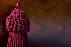 Burgundy silk decoration knot. Close up of a fashionable burgundy silk decoration knot Royalty Free Stock Images