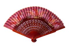 Burgundy spanish wooden hand fan. Spanish traditional hand fan with the pattern, isolated on white background Stock Images