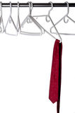 Burgundy tie on a hanger Royalty Free Stock Images