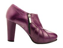 Burgundy woman shoe side view isolated. On white royalty free stock photo
