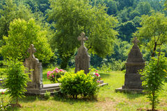 Burial in garden of monastery Moraca. Montenegro. Moraca Monastery is a Serbian Orthodox monastery located in the valley of the Moraca River in Kolasin, central stock images