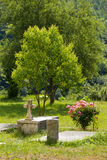 Burial in garden of monastery Moraca. Moraca Monastery is a Serbian Orthodox monastery located in the valley of the Moraca River in Kolasin, central Montenegro royalty free stock photo