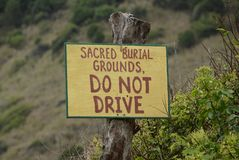 Burial Grounds Sign. Sacred burial grounds in the Halawa Valley of Molokai stock photos