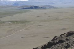 Burial mounds in Central Asia. Bronze and Iron age royalty free stock photo