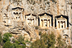 Burial tombs, Turkey. Ancient Lycian royal burial rock tombs carved in cliff on river Dalyan in Turkey Royalty Free Stock Images