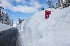 Buried Avalanche Sign in Snowy Walls stock photos