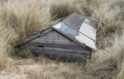 Buried Beach Hut. Beach Hut Buried in Sand Dunes at Brancaster, Norfolk, UK Royalty Free Stock Photos