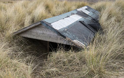 Buried Beach Hut. Beach Hut Buried in Sand Dunes at Brancaster, Norfolk, UK Stock Photos
