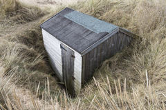 Buried Beach Hut. Beach Hut Buried in Sand Dunes at Brancaster, Norfolk, UK Royalty Free Stock Photography